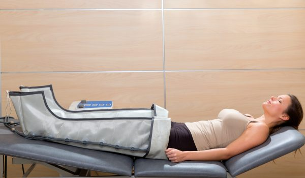 legs pressotherapy machine on woman patient in hospital